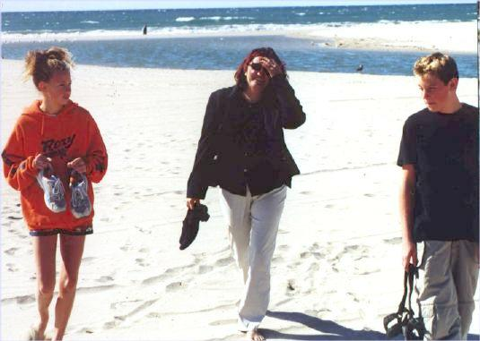 Liese, Deb and Tim walking on the beach at Venice